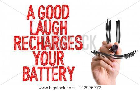 Hand with marker writing: A Good Laugh Recharges Your Battery