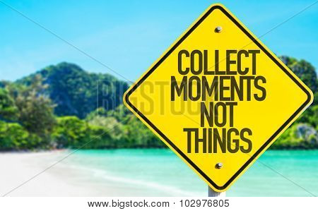Collect Moments Not Things sign with beach background