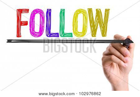 Hand with marker writing: Follow