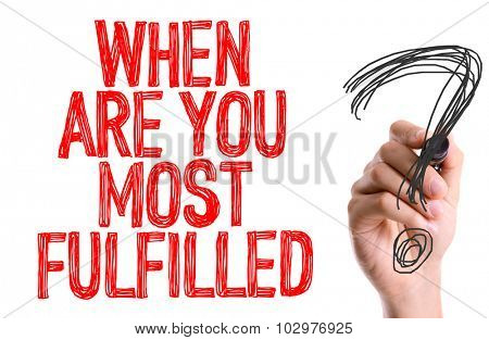 Hand with marker writing: When Are You Most Fulfilled?