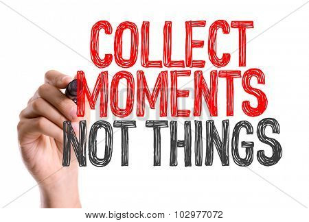 Hand with marker writing: Collect Moments Not Things