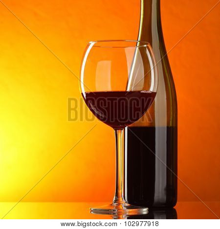 Red wine - still-life with glass and bottle with copyspace