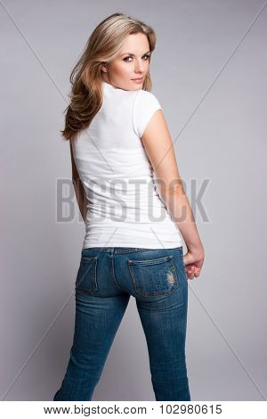 Beautiful blond woman wearing jeans and white tshirt