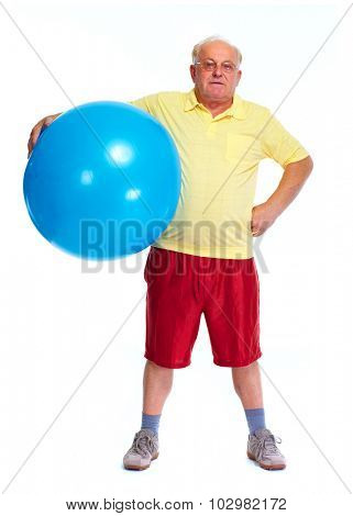 Elderly man with exercise ball. Sport and health.