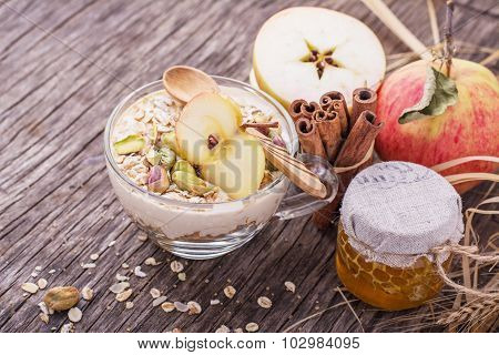 Overnight Oatmeal with yogurt, ground cinnamon and caramel flavored slice of apple