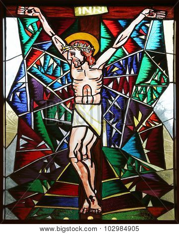 MACELJ, CROATIA - APRIL 05: Crucifixion, stained glass window in Memorial Church of the Passion of Jesus in Macelj, Croatia on April 05, 2014