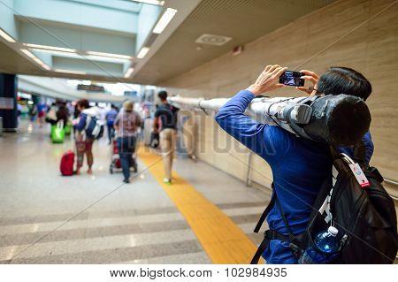 ROME, ITALY - AUGUST 16, 2015: passenger take photo how he move oversize laggage in Fiumicino Airport. Fiumicino - Leonardo da Vinci International Airport is a major international airport in Rome