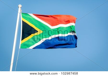 South African Flag On A Blue Sky - Pride Of The Nation South Africa Adopted On 27 April 1994
