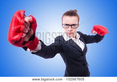 Woman with boxing gloves on white