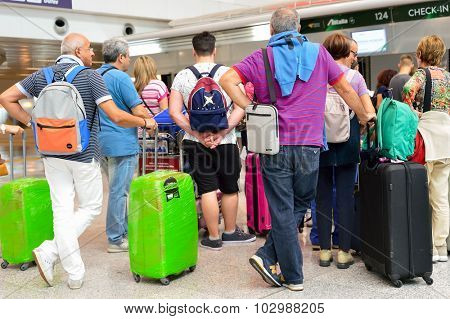 ROME, ITALY - AUGUST 16, 2015: passengers on departure floor of Fiumicino Airport. Fiumicino - Leonardo da Vinci International Airport is a major international airport in Rome, Italy
