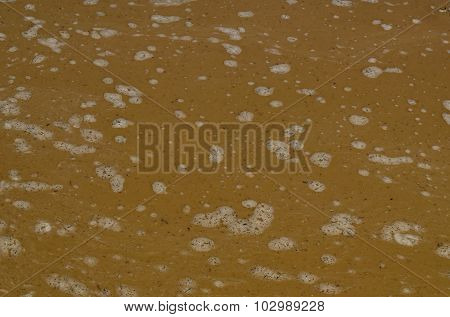 Beauty background of water figures in the puddle after flood rain