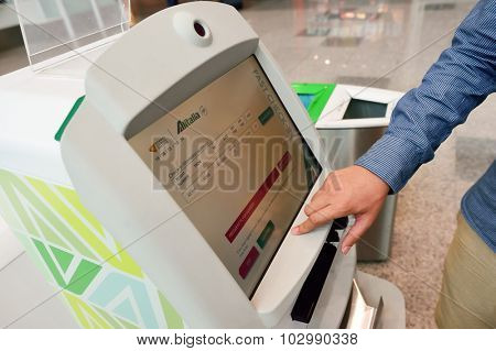 ROME, ITALY - AUGUST 16, 2015: people use self check-in kiosks in Fiumicino Airport. Fiumicino - Leonardo da Vinci International Airport is a major international airport in Rome, Italy