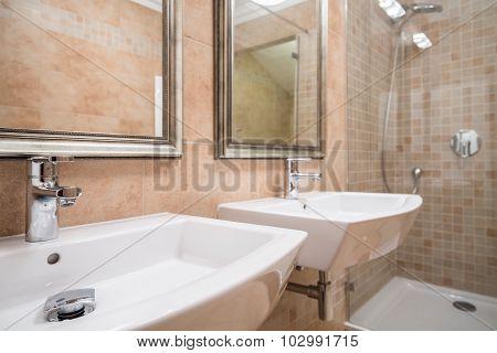 Two White Washbasins