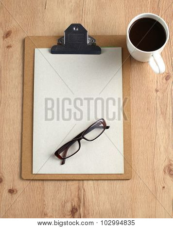 cup coffee and note paper on wood background