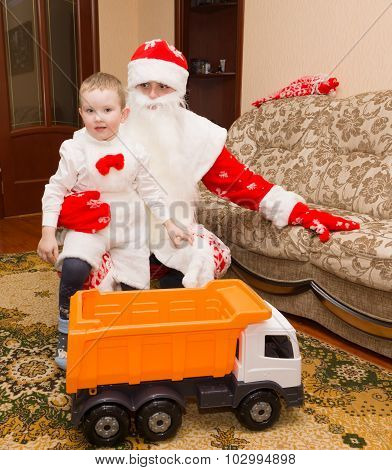 Santa Claus Came To Visit And Brought The Boy A Gift