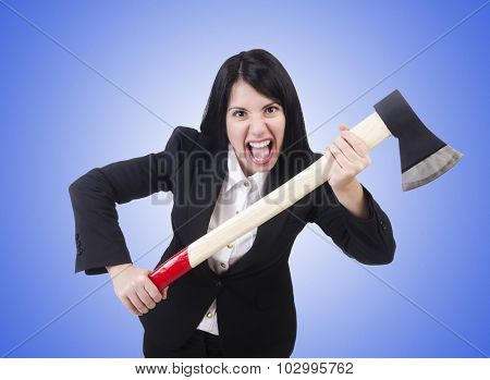 Angry businesswoman with axe on white