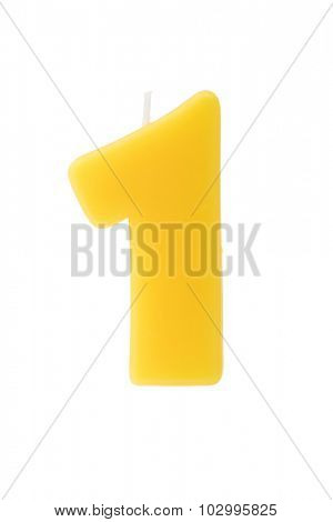Yellow birthday candle in the form of a number on white background
