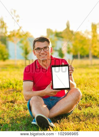 Man Holding And Shows Touch Screen Tablet Pc