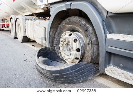 Closeup Damaged 18 Wheeler Semi Truck Burst Tires By Highway Street.