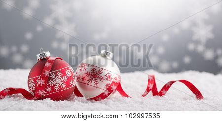Christmas balls with decoration on shiny background