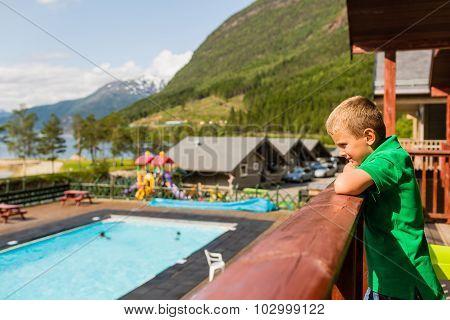Boy At Summer Holiday Resort In Norway