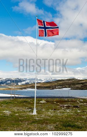 Norwegian Flag On Flagpole In Norway