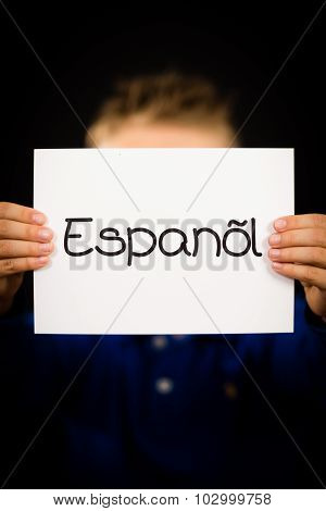 Child Holding Sign With Spanish Word Espanol - Spanish In English