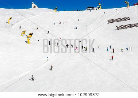 Skiers On Crowded Ski Slope