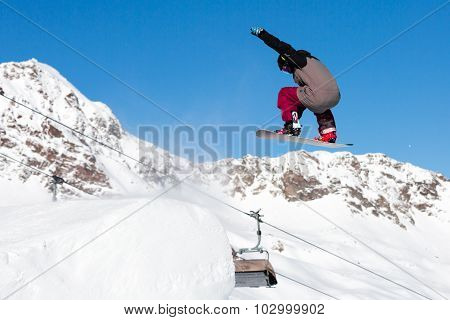 Snowboarder Jumping In Snow Park