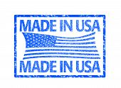 image of the united states america  - grunge rubber stamp with the flag of the United States of America and the text made in USA written inside - JPG