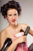 Постер, плакат: Funny Girl Styling Hair Holds Many Accessories