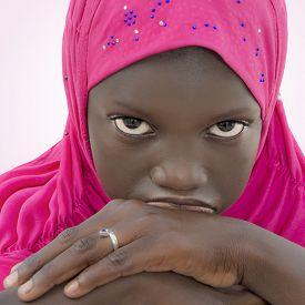 foto of ten years old  - Moody girl wearing a pink headscarf - JPG