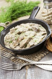 picture of liver fry  - Liver stewed in sour cream in a frying pan - JPG