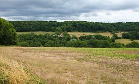 stock photo of paysage  - Countryside of Perche under a cloudy sky close to Mortagne - JPG