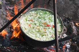foto of cauldron  - vegetables prepared in a cauldron over a fire on the nature - JPG
