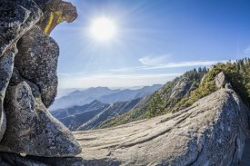 stock photo of granite dome  - Moro Rock against sun unique granite dome rock formation in Sequoia National Park USA - JPG