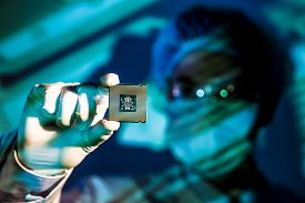 image of microchips  - Cropped image of an engineer holding computer microchip on the foreground - JPG