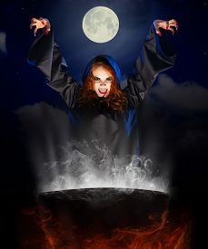 pic of cauldron  - Young witch with cauldron on night sky background - JPG