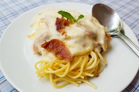 picture of carbonara  - Spaghetti carbonara with bacon and cheese at restaurant - JPG