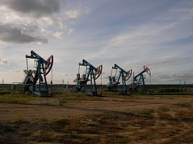 stock photo of raw materials  - Long line of oil pumping units on a large - JPG