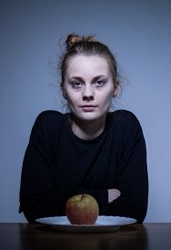 foto of bulimic  - Portrait of a devastated female with eating disorder - JPG