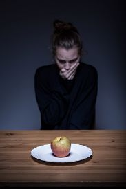 stock photo of bulimic  - Image of a lonely anorexic having nausea - JPG