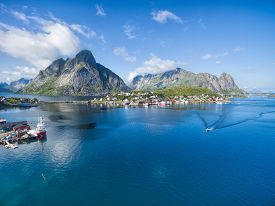 stock photo of reining  - Scenic aerial view of fishing town Reine on Lofoten islands in Norway famous tourist destination