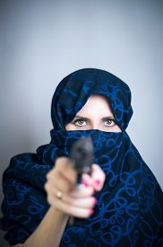 stock photo of yashmak  - Woman suicide paranzhe shoots a gun photo studio  - JPG