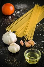 picture of raw materials  - Raw material and ingredient for Italian pasta recipe. ** Note: Shallow depth of field - JPG