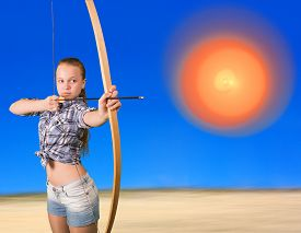 stock photo of archery  - Teen girl practicing archery aiming in abstract sphere - JPG