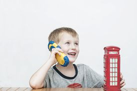pic of phone-booth  - Boy talking on the phone and vintage british red telephone booth - JPG