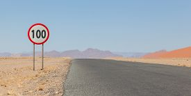 foto of mph  - Speed limit sign at a desert road in Namibia speed limit of 100 kph or mph - JPG