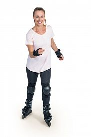 stock photo of inline skating  - Portrait of happy sporty woman inline skating over white background - JPG
