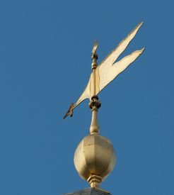 image of wind vanes  - A Golden Wind Vane on a building - JPG